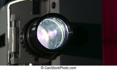 Vintage movie projector lens closeup