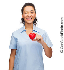 smiling female doctor or nurse with heart - healthcare and...