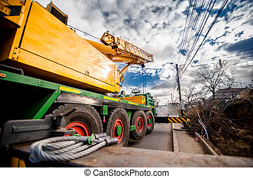 industrial heavy duty mobil crane against cloudy and blue...