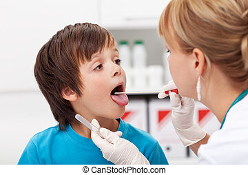 Boy at the doctor being examined and giving biological...
