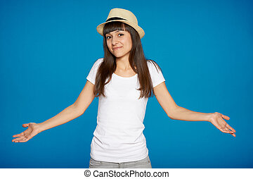 Shrugging woman in doubt doing shrug showing open palms.
