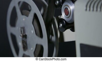 Strip of 16 mm film in movie projector