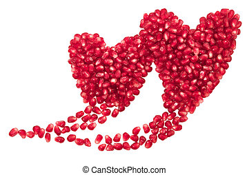 Two hearts - Pomegranate seeds in two hearts shape isolated...