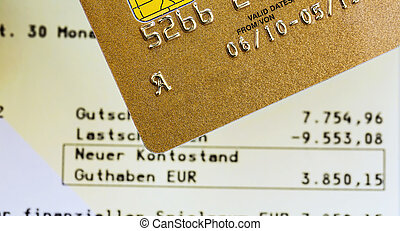 credit card and bank statement - a golden credit card and...