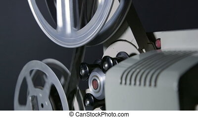 Rewind strip of 16 mm film in movie projector - Rewind strip...