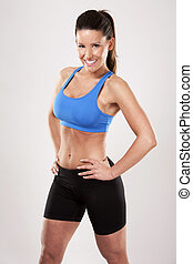 fitness woman - fitness model brunette wearing blue outfit...