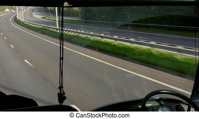 Bus windscreen view - View of the dashboard, motorway and...