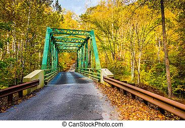 Autumn color and a bridge in Gunpowder Falls State Park,...