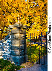 Autumn color and the gate of the Gettysburg National Cemetary, Pennsylvania.