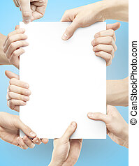 many hands holding poster - many hands holding paper poster...