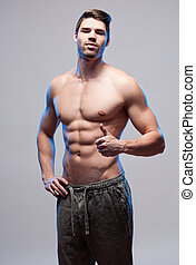 Cool and fit. - Portrait of a very fit young brunette guy.