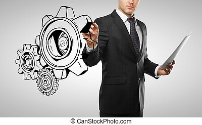 man drawing gears - businessman drawing gears on white...