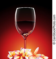 a glass of wine with flowers