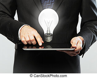tablet and lamp - man with digital tablet in hands and lamp