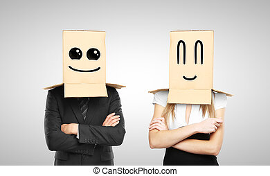 smiling box on head - businessman and woman with smiling box...