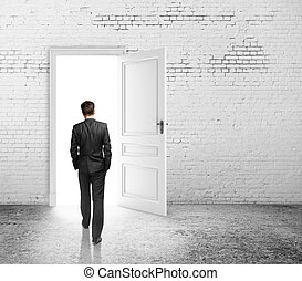 opened door - businessman walking to opened loft door