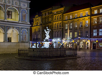 Fragment of the historical town square in Poznan, Poland with a fountain and city hall
