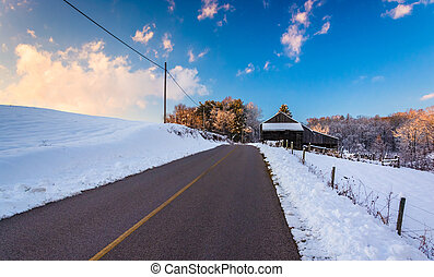 Barn and snow covered fields along a country road in rural York County, Pennsylvania.