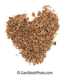 Heart from grated chocolate isolated on white