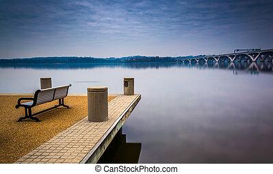 Bench along the Potomac River, in Alexandria, Virginia. -...