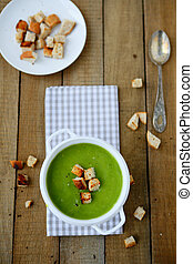 Cream soup of spinach  and broccoli, food closeup