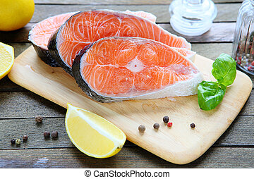 fresh salmon fillet on a board, food closeup