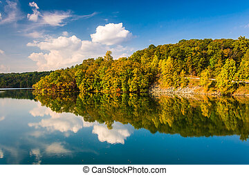 Clouds and trees reflecting in Prettyboy Reservoir,...