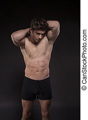 Fitness man, low key - Fitness man on black background torso