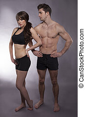 Young couple exercise together - Young fitness couple in the...