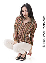 Squat pose by sexy Asian beauty, full length portrait...