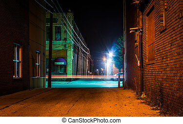 Dark alley and light trails in Hanover, Pennsylvania at...