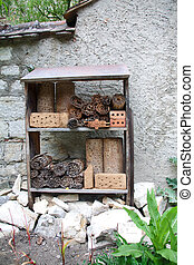 Insect hotel and stone heap underneath for small wild...