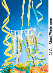 Sparkling wine - Two glass of sparkling wine, streamers and...