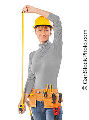 a young female holding a tape measure wearing work clothes...