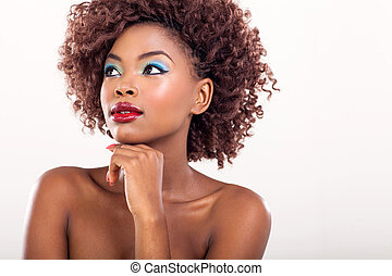 young african american woman looking away on plain...