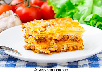 Italian lasagna on a plate - Delicious italian lasagna on a...