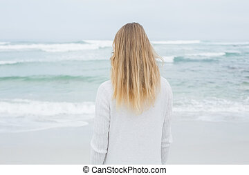 Rear view of a casual blond at beach - Rear view of a casual...