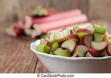 Rhubarb - Fresh rhubarb on wooden background. Shallow dof