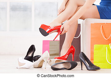 Woman at shoe store. Cropped image of young woman choosing...