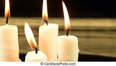 candles - picture of burning candles on black background