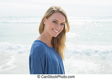 Portrait of a smiling casual woman at beach - Portrait of a...