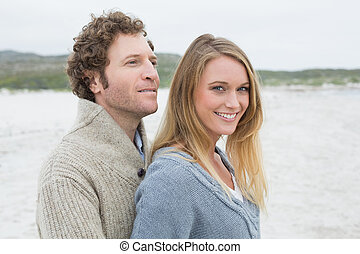 Relaxed romantic young couple at beach