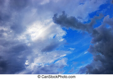 Dramatic cloudy sky - lumen of blue sky which tightened...