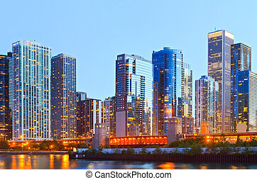 Colorful buildings in downtown Chicago during sunset with...