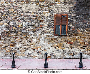 Old wall from stone and window with lattice window - ld...