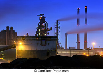 Blast Furnace - The menacing outline of a blast furnace,...