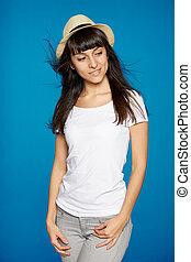 Smiling carefree woman wearing white straw hat