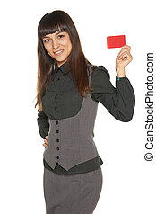 Smiling business woman holding credit card isolated on white...