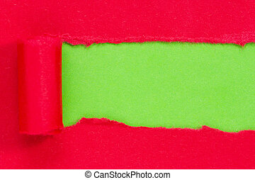 Red paper torn to reveal green panel ideal for copy space