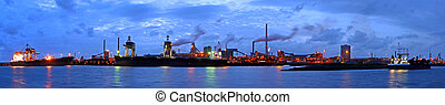 Steelworks at night - A panorama of a steel plant at...